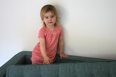 Hopscotch dress on sofa