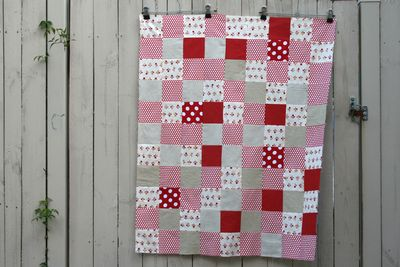 Red and white cot quilt