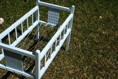 Antique doll cot before