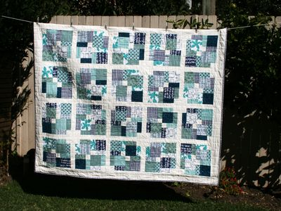Finished disappearing nine patch quilt