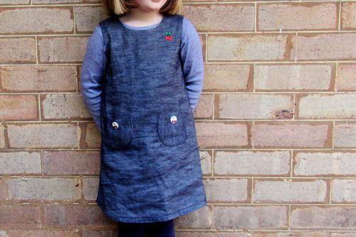 Denim pinafore worn